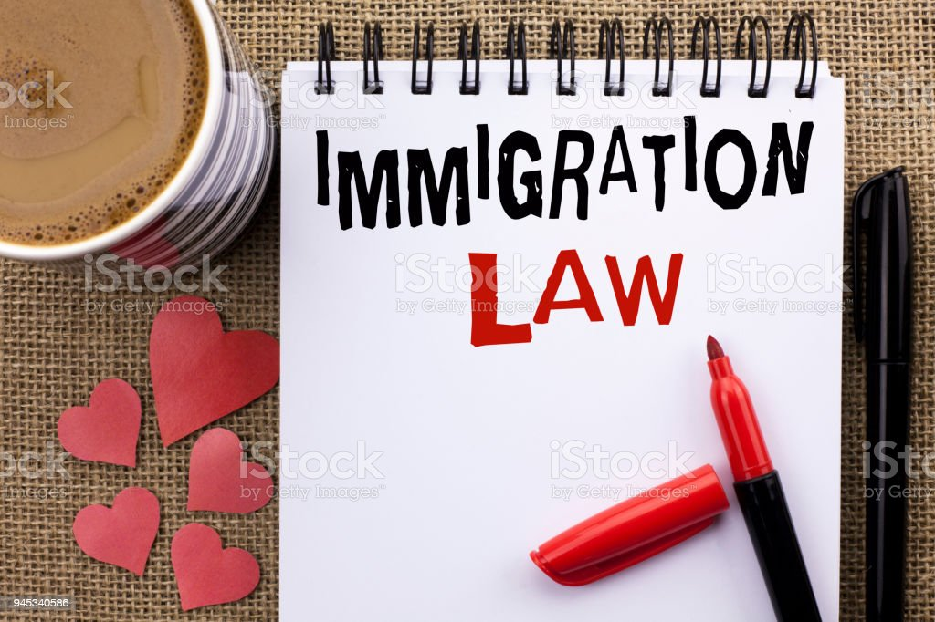 Conceptual hand writing showing Immigration Law. Business photo showcasing National Regulations for immigrants Deportation rules written on Notebook Book on the jute background Cup Hearts Pen stock photo