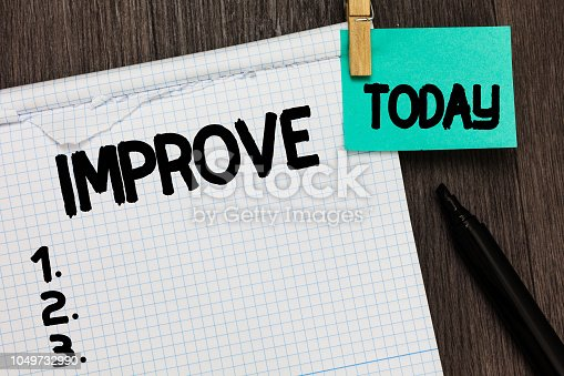 istock Conceptual hand writing showing Improve. Business photo showcasing Make become better Development increase capacities Grow Change Notebook holding reminder important message wood background. 1049732990