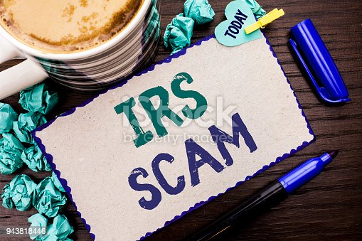 istock Conceptual hand writing showing Irs Scam. Business photo showcasing Warning Scam Fraud Tax Pishing Spam Money Revenue Alert Scheme written Cardboard Piece on wooden background Today Pen Coffee. 943818446