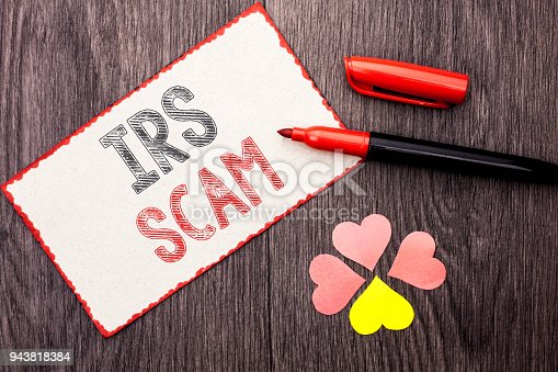 istock Conceptual hand writing showing Irs Scam. Business photo text Warning Scam Fraud Tax Pishing Spam Money Revenue Alert Scheme written on Cardboard Piece With Marker on wooden background Hearts. 943818384