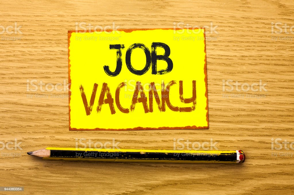 Conceptual hand writing showing Job Vacancy. Business photo showcasing Work Career Vacant Position Hiring Employment Recruit Job written on Yellow Sticky Note on wooden background Pencil. stock photo