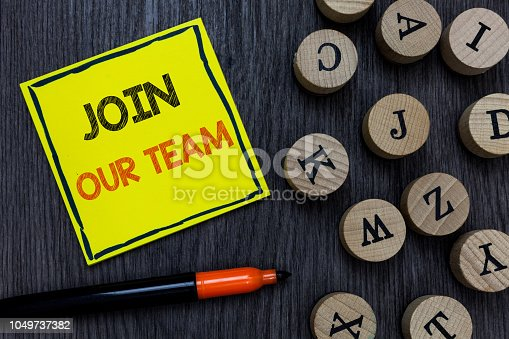 istock Conceptual hand writing showing Join Our Team. Business photo showcasing Allied Associate Work with us New Employee Hired Enlist Yellow paper circle Marker express ideas wooden background. 1049737382
