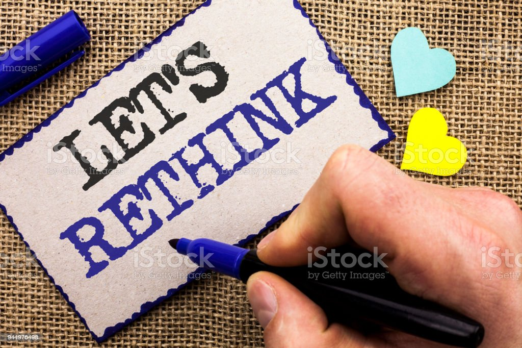 Conceptual hand writing showing Let Us Rethink. Business photo showcasing Give people time to think things again Remodel Redesign written on Sticky Note on the jute bakground with Love Hearts. stock photo