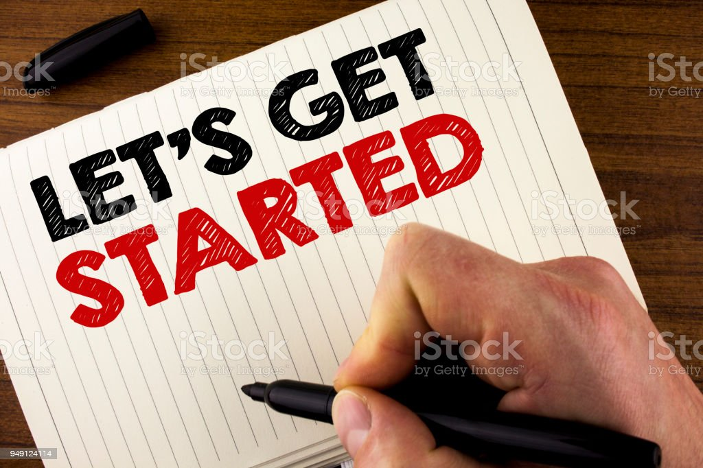Conceptual hand writing showing Lets Get Started. Business photo showcasing beginning time motivational quote Inspiration encourage written by Man on Notebook Book on Wooden background Marker. stock photo