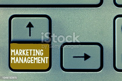 istock Conceptual hand writing showing Marketing Management. Business photo showcasing Develop Advertise Promote a new Product or Service 1049732970