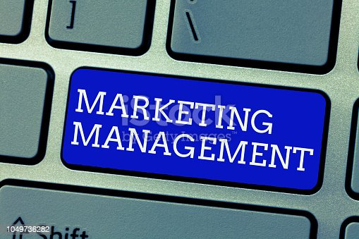 istock Conceptual hand writing showing Marketing Management. Business photo showcasing Develop Advertise Promote a new Product or Service 1049736282