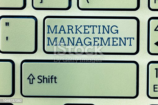 istock Conceptual hand writing showing Marketing Management. Business photo showcasing Develop Advertise Promote a new Product or Service 1049737052