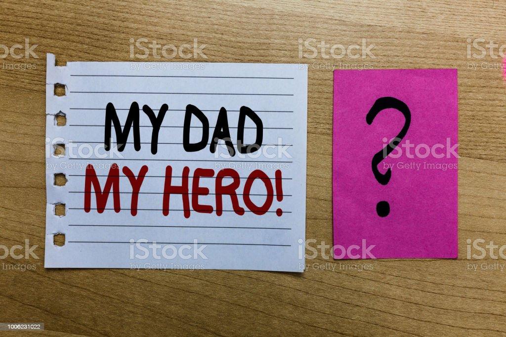 Conceptuelle main écrit montrant mon papa mon héros activité photo