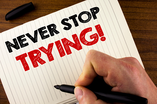 istock Conceptual hand writing showing Never Stop Trying Motivational Call. Business photo showcasing go on do not give up Self confidence written by Man on Notebook Book on Wooden background Marker. 949425508
