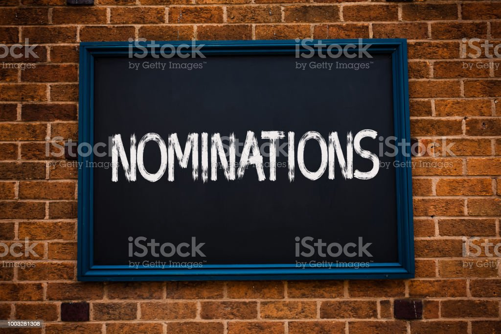 Conceptual hand writing showing Nominations. Business photo showcasing Suggestions of someone or something for a job position or prize Framed hang black board study class brick wall background. stock photo