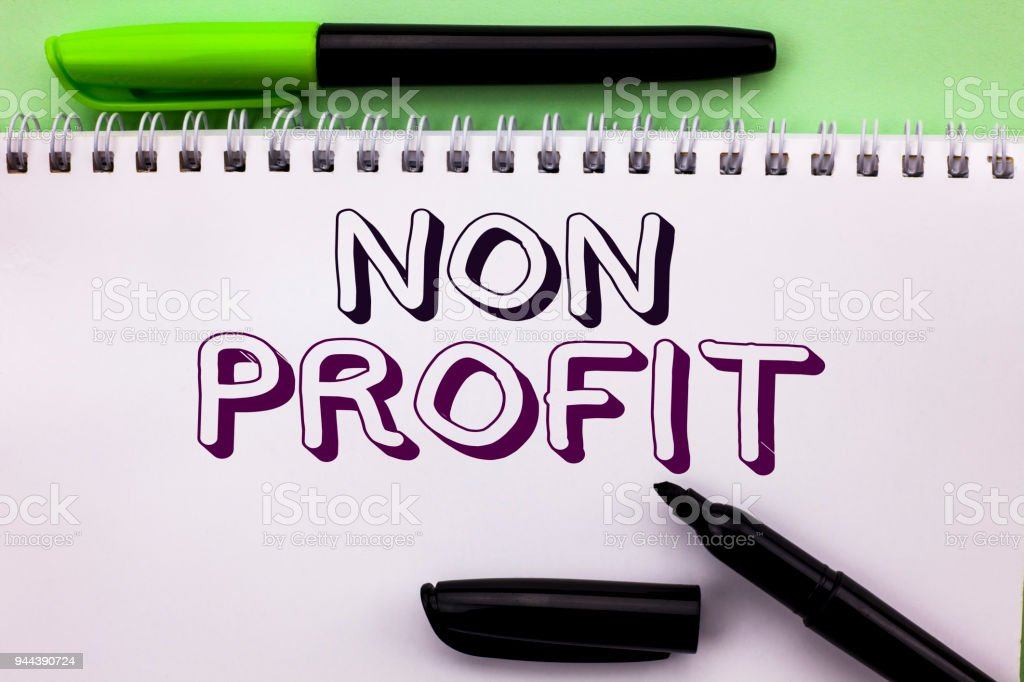 Conceptual hand writing showing Non Profit. Business photo showcasing Charitable Wrothless Philanthropy Aid Unlucrative Profitless written on Notebook Book on the Plain background Marker Pen stock photo