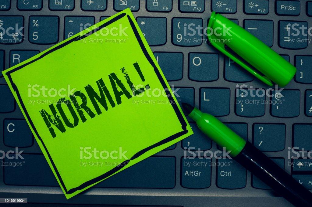 Foto De Conceitual Mão Escrevendo Mostrando Normal Chamar