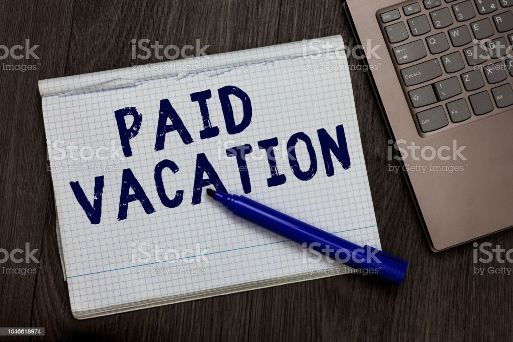 Conceptual hand writing showing Paid Vacation. Business photo text Sabbatical Weekend Off Holiday Time Off Benefits Open notebook squared page black marker computer wooden background. stock photo