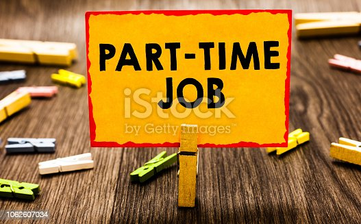 Conceptual hand writing showing Part Time Job. Business photo showcasing Weekender Freelance Casual OJT Neophyte Stint Seasonal Clothespin holding orange paper note clothespin wooden floor