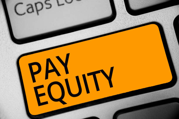 Conceptual hand writing showing Pay Equity. Business photo showcasing eliminating sex and race discrimination in wage systems Keyboard orange key computer computing reflection document. stock photo