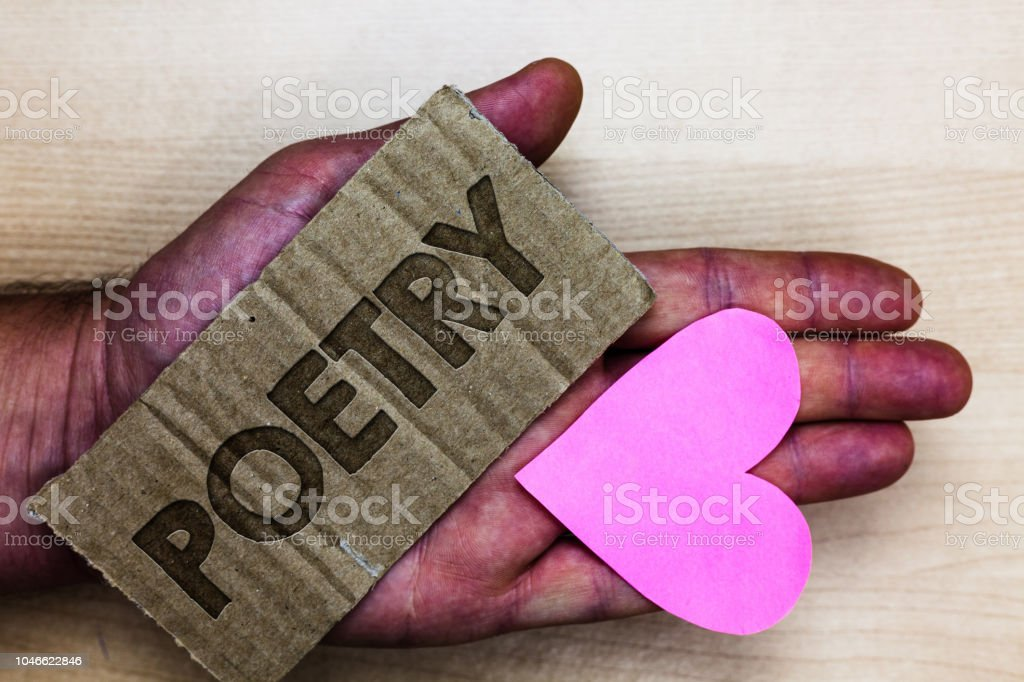 Conceptual hand writing showing Poetry. Business photo text Literary work Expression of feelings ideas with rhythm Poems writing Packing card inscribed text love heart hand recycle make useful.