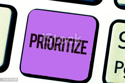 istock Conceptual hand writing showing Prioritize. Business photo showcasing Organize designate or treat something as being more important 1049736266