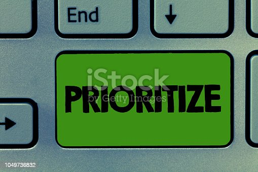 istock Conceptual hand writing showing Prioritize. Business photo showcasing Organize designate or treat something as being more important 1049736832