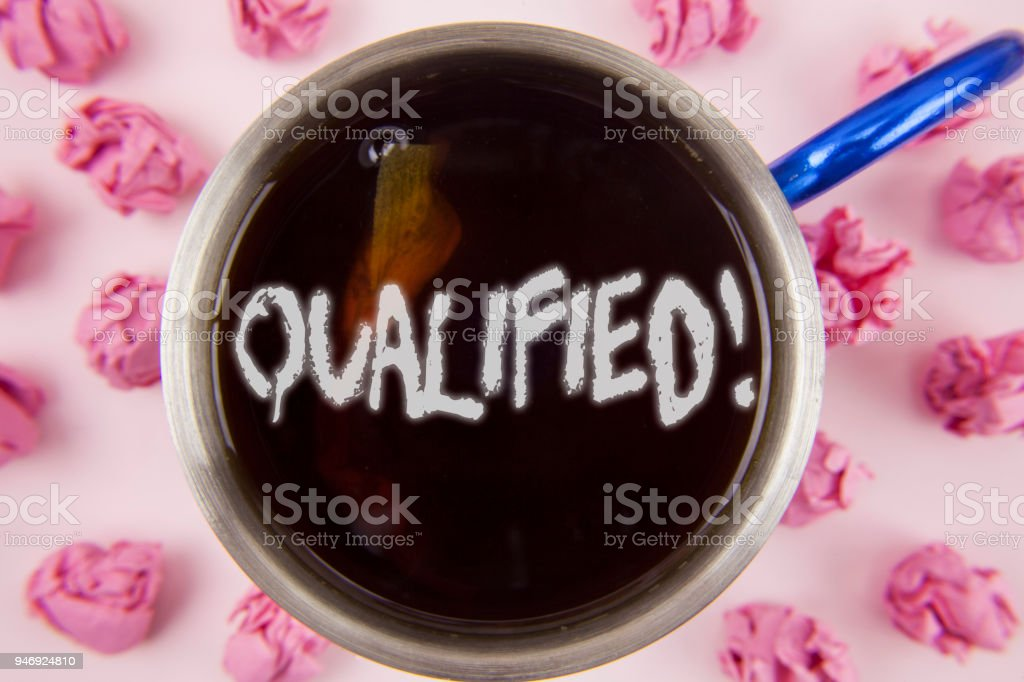 Conceptual hand writing showing Qualified Motivational Call. Business photo showcasing Certified to perform a job Competent Experienced written on Tea in Cup within Paper Balls on plain background. stock photo