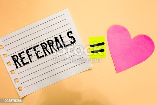 istock Conceptual hand writing showing Referrals. Business photo showcasing Act of referring someone or something for consultation review Love equation memory thought orange heart lovely art papers. 1003875286