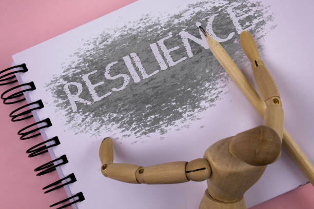 conceptual hand writing showing resilience. business photo showcasing capacity to recover quickly from difficulties persistence written on notepad plain background wooden jointed toy pencil - resilience concept stock photos and pictures