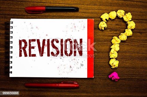 istock Conceptual hand writing showing Revision. Business photo text Rechecking Before Proceeding Self Improvement Preparation Marker notepad nice art ask crumpled papers mistakes several tries. 999656666