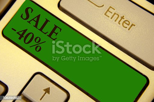 Conceptual hand writing showing Sale 40. Business photo text A promo price of an item at 40 percent markdown Keyboard green key create computer computing reflection document