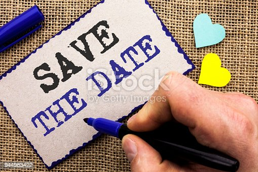 istock Conceptual hand writing showing Save The Date. Business photo showcasing Remember not to schedule anything else that time Appointment written on Sticky Note on the jute bakground with Love Hearts. 944983422