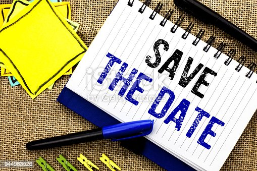 istock Conceptual hand writing showing Save The Date. Business photo showcasing Remember not to schedule anything else that time Appointment written on Notebook Book on the jute background Clips and Pens 944983526