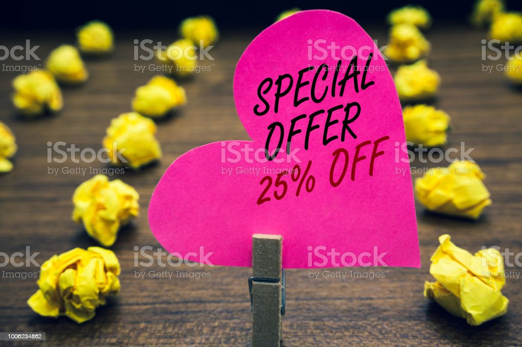 Conceptual hand writing showing Special Offer 25 Off. Business photo text Discounts promotion Sales Retail Marketing Offer Paperclip hold pink written heart woody floor with yellow lobs. stock photo