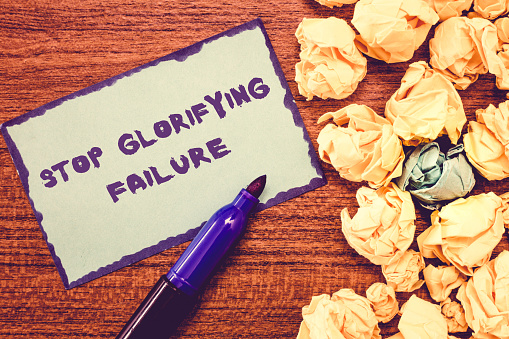 istock Conceptual hand writing showing Stop Glorifying Failure. Business photo showcasing do not let Breakdown Rule your life Try again 1039931780