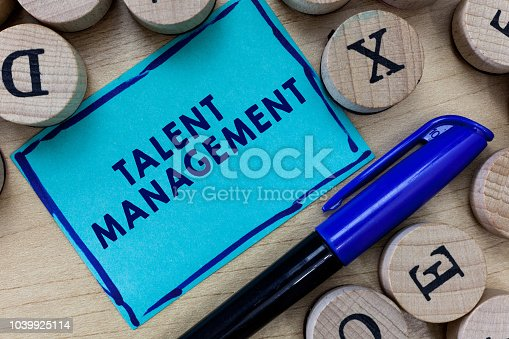 istock Conceptual hand writing showing Talent Management. Business photo text Acquiring hiring and retaining talented employees 1039925114