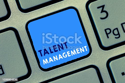 istock Conceptual hand writing showing Talent Management. Business photo text Acquiring hiring and retaining talented employees 1039954836