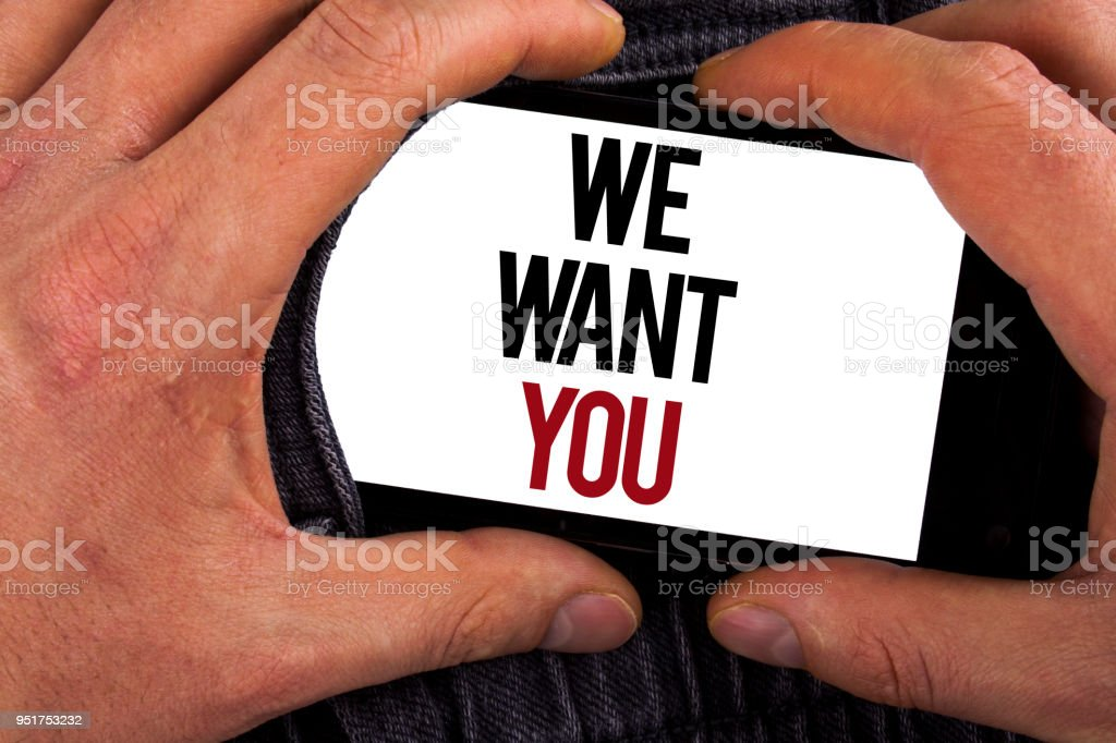 Conceptual hand writing showing We Want You. Business photo showcasing Employee Help Wanted Workers Recruitment Headhunting Employment written on Mobile holding by man on the Jeans background. stock photo
