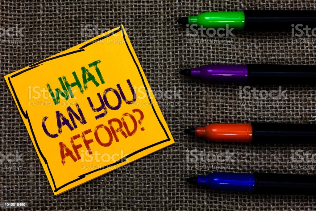 Conceptual hand writing showing What Can You Afford question. Business photo text Give us your budget availability of money Written on black lined yellow transverse note pen jute ground. stock photo