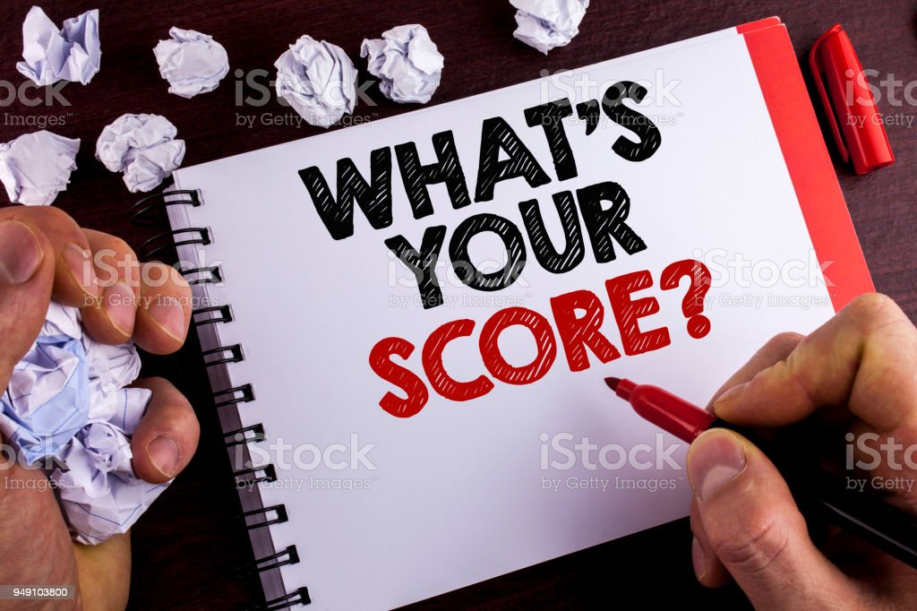 Conceptual hand writing showing What Is Your Score Question. Business photo text Tell Personal Individual Rating Average Results written by Man on Notepad on wooden background Marker Paper Balls stock photo