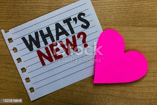 istock Conceptual hand writing showing What s is New question. Business photo showcasing Asking about latest Updates Trends Happening News Notebook paper Romantic ideas heart feelings Wooden table. 1022816648