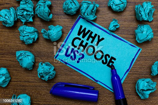 istock Conceptual hand writing showing Why Choose Us question. Business photo showcasing Reasons for choosing our brand over others arguments written blue letters on page blue marker and paper lumps. 1006241282