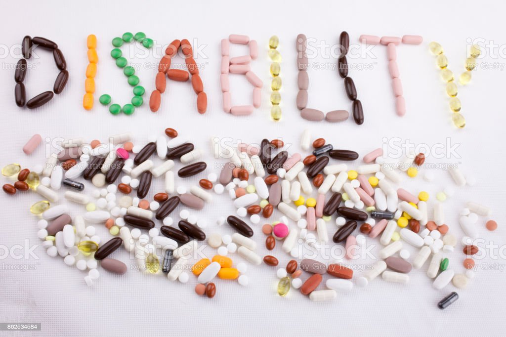 Conceptual Hand writing text caption inspiration Medical care Health concept written with pills drugs capsule word disability On white isolated background with copy space stock photo
