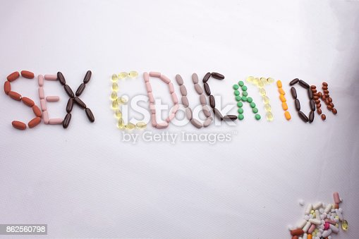 istock Conceptual Hand writing text caption inspiration Medical care Health concept written with pills drugs capsule word Sex education season On white isolated background with copy space 862560798