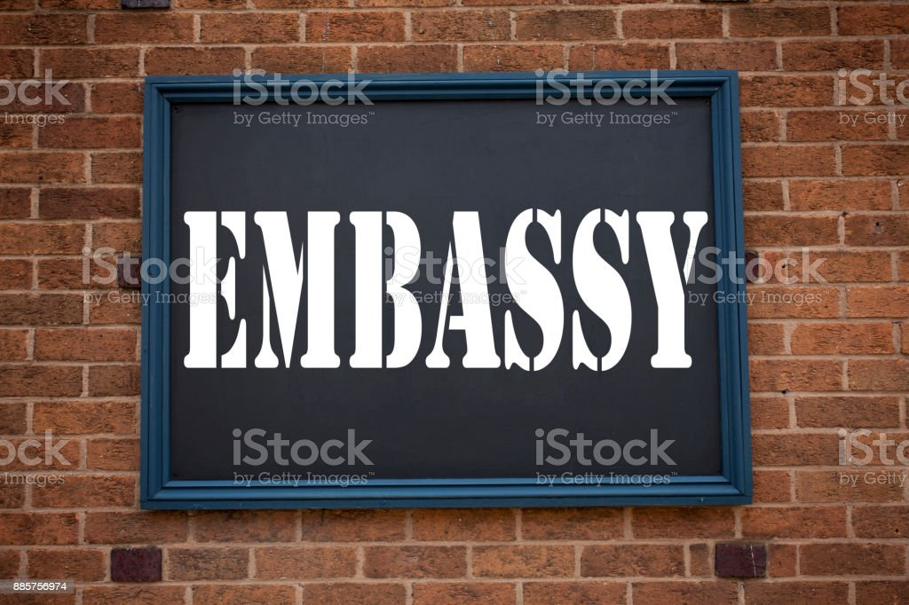 Conceptual hand writing text caption inspiration showing announcement Embassy. Business concept for Tourist Visa Application written on frame old brick background with copy space stock photo