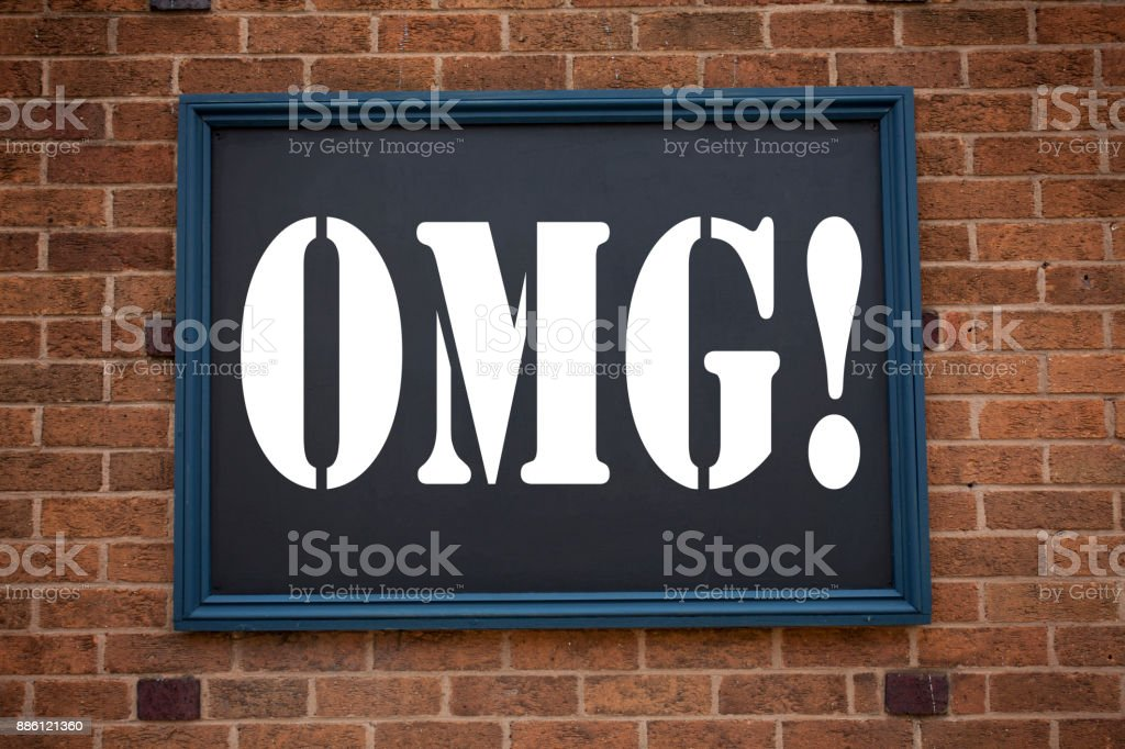 Conceptual hand writing text caption inspiration showing announcement OMG Oh My God. Business concept for Surprise Humor written on frame old brick background with copy space stock photo