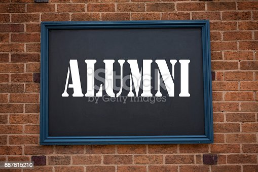 istock Conceptual hand writing text caption inspiration showing announcement Alumni Former Students. Business concept for  Celebration Education Ending written on frame old brick background with copy space 887815210