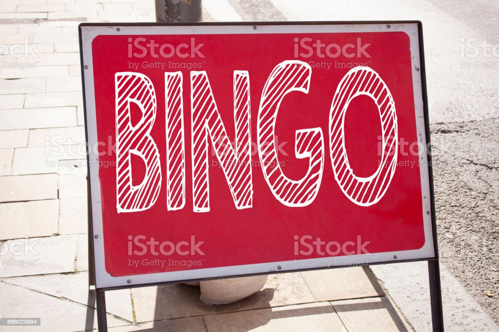 Conceptual hand writing text caption inspiration showing Bingo. Business concept for Lettering Gambling to Win Price Success written on announcement road sign with background and copy space stock photo