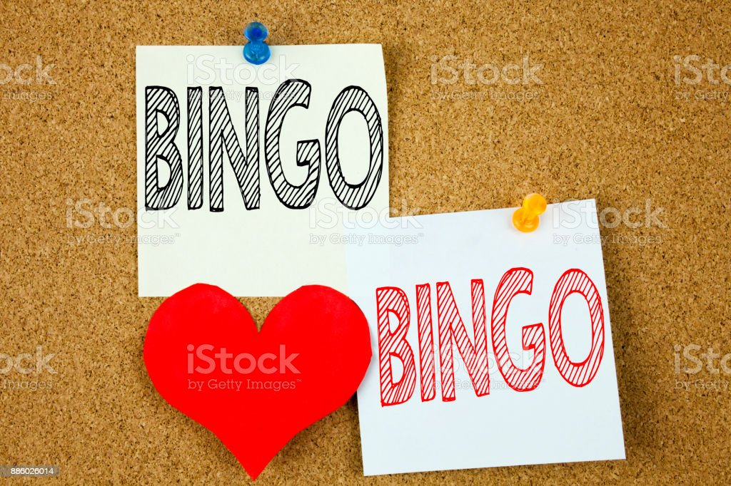 Conceptual hand writing text caption inspiration showing Bingo concept for Lettering Gambling to Win Price Success and Love written on sticky note, reminder cork background with copy space stock photo