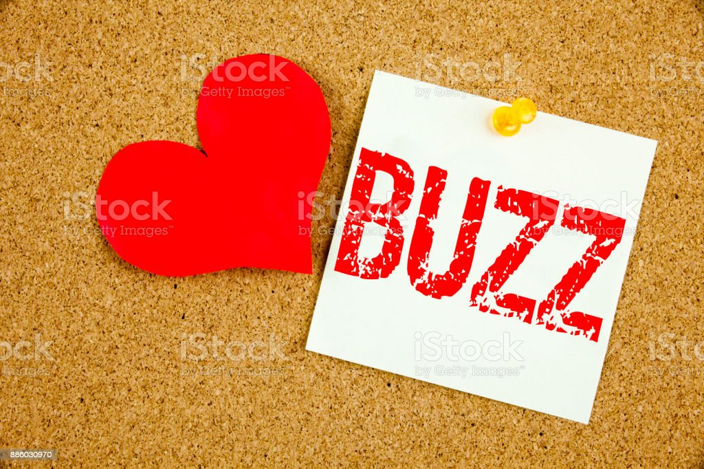 Conceptual hand writing text caption inspiration showing Buzz concept for Buzz Word llustration and Love written on sticky note, reminder cork background with copy space stock photo