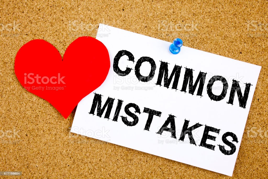 Conceptual hand writing text caption inspiration showing Common Mistakes concept for Common Decision Mistakes and Love written on sticky note, reminder cork background with copy space stock photo