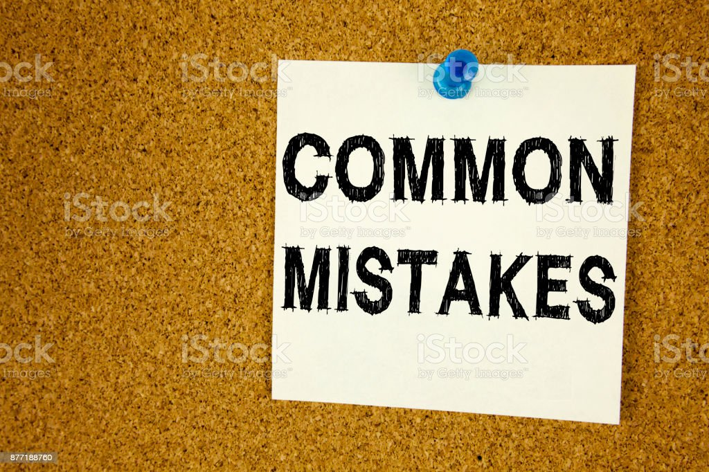 Conceptual hand writing text caption inspiration showing Common Mistakes. Business concept for Common Decision Mistakes written on sticky note, reminder cork background with copy space stock photo