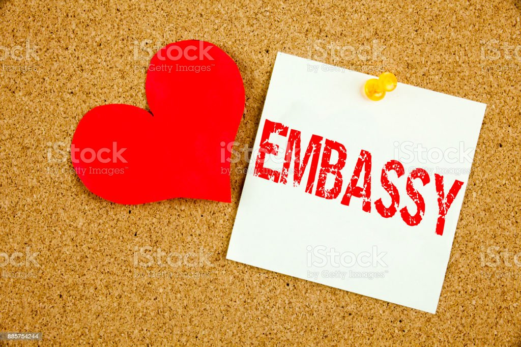 Conceptual hand writing text caption inspiration showing Embassy concept for Tourist Visa Application and Love written on sticky note, reminder cork background with copy space stock photo