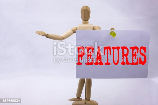 istock Conceptual hand writing text caption inspiration showing Features Business concept for Advertisement Advertising written on sticky note sculpture background with space 887669934